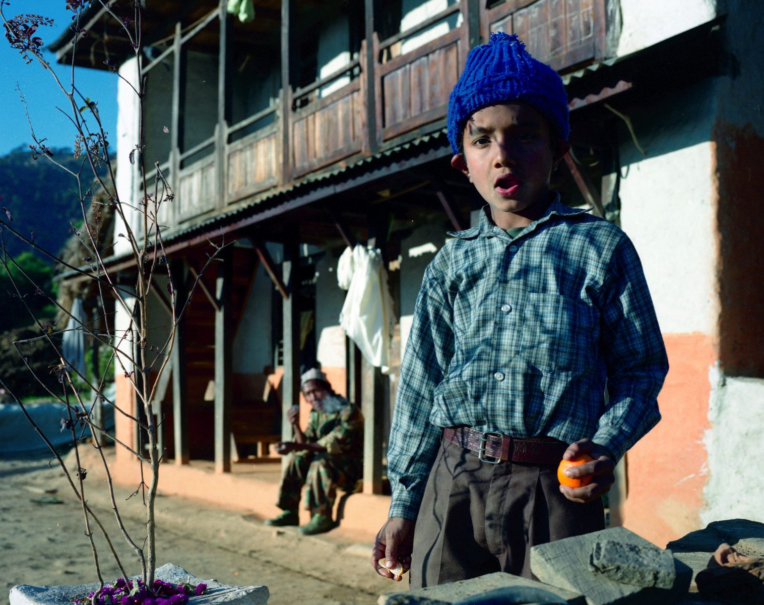 Nepal orange and blue hat